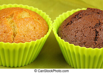 Muffins - Closeup of two cupcakes - chocolate and lemon