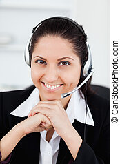 Smiling operator in office