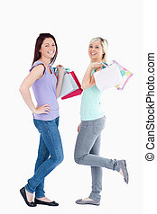 Joyful women with shopping bags