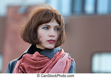 Beautiful woman on a street - Thoughtful young woman on the...