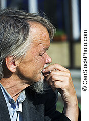 Sad old man - Sad beggar grieving for problems of the life.