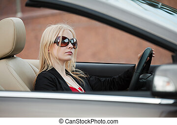Young woman driving a convertible
