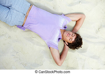 Resting guy - Above angle of handsome teenager lying on...