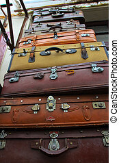 Pyramid of vintage old suitcases piled on top of one another...