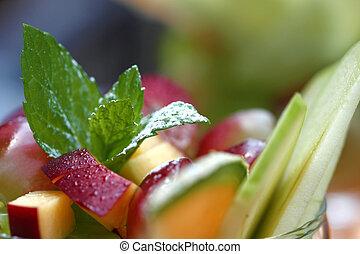 Fruit salad - Fruit dessert with mint leaf