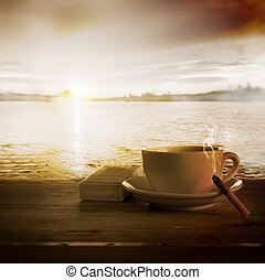 Loneliness. Coffee and Cigarette Burning Down against Sunset