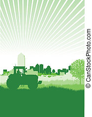 tractor in a field in front of a cityscape