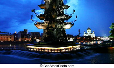 Illuminated monument to Peter Great and fountains in Moscow River