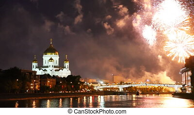 Bright fireworks erupt over bridge at Cathedral of Christ Savior in Moscow night sky