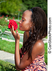 Outdoor portrait of a young beautiful african american girl...