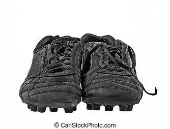 Soccer shoes - Close up of black used soccer shoes over...