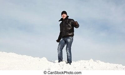 The man is dancing on the slope and then falls on the snow