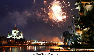 Bright fireworks erupt between monument Peter Great and Cathedral of Christ Savior