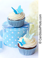 Butterfly cupcakes - Chocolate cupcakes decorated with sugar...