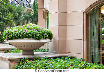 Big stone flowerpot in garden - Big stone park/garden...