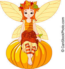 Autumn fairy girl sitting on pumpkin