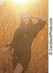 Redhead Model Amongst Wheat Fields in the Warm Sun. -...