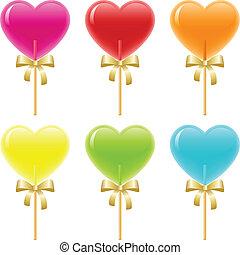 Heart Lollipops - Heart shaped lollipops with ribbons.