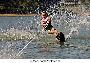 Young Girl Water skiing - Young girl skiing on a slalom...