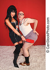 Dominatrix Spanking Eager Man - A dominatrix woman paddles...