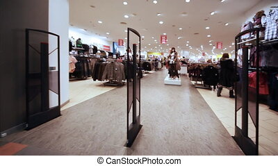 Panorama entrance from control rack in shopping room of clothes