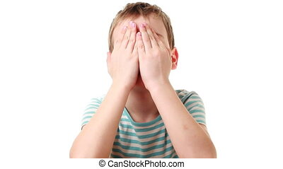 Boy shows focus closing and opening face with hands each...