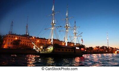 Sailing ship standing at pier on night Neva river - sailing...