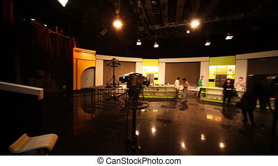 Professional television cameras shoot people on TV shows in...