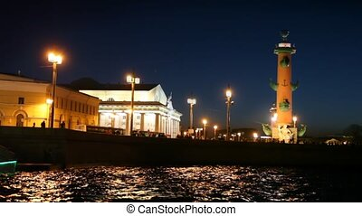 People walk on embankment Neva at night, Vasilievsky...