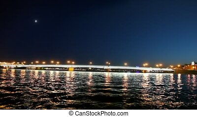 Departure from Blagoveshchensk bridge shined in night -...