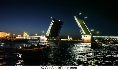 Some boats swim about dissolved palace bridge on Neva - some...