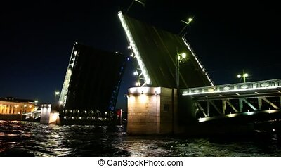 Raised drawbridge night on Neva illuminated