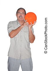 Senior man holding bowling ball isolated - Senior man...