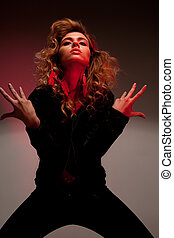 red light - picture of fashionable woman in black clothes in...
