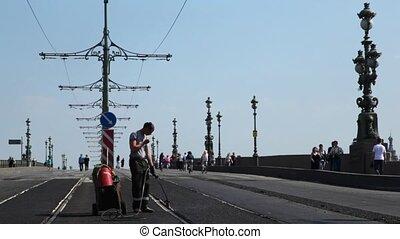 Worker on repair of Liteyny Bridge