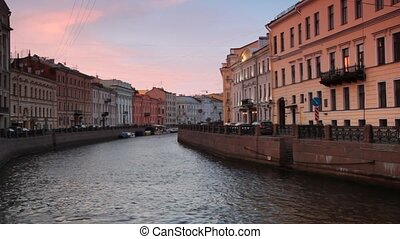 Sunset over embankment of the River Mojka