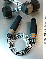 Gym Equipment - Gym sporting equipment on metalic background