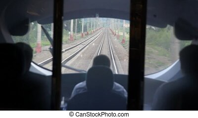 View from train cabin of operator during movement by railroad