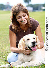 Young woman with her dog - Woman playing with her dog...