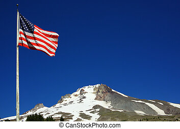 American Flag Mount Hood - An American Flag flying with...