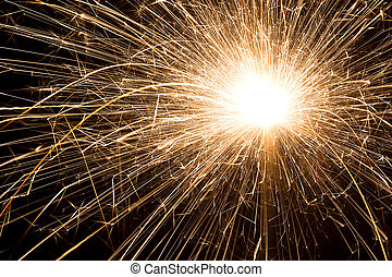 Sparkler Closeup - A flowing sparkler up close as it emits...