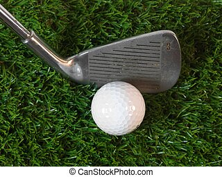 Golfing equipment on artficial grass outdoors