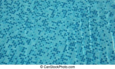 Small heaving waters in pool with blue mosaic bottom - small...