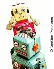 robots - two retro robot toys on white