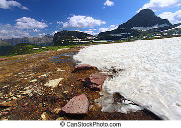 Logan Pass Snowfall - Snow remains even in late August at...