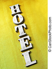 hotel -  hotel sign on old yellow wall
