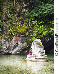 Buddhist Shrine - A white buddhist shrine in the mountains...