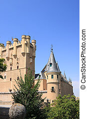 The Alcazar Segovia, Spain - Rising up over a rocky hill at...
