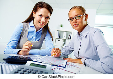 Happy employees - Portrait of happy young businesswomen...