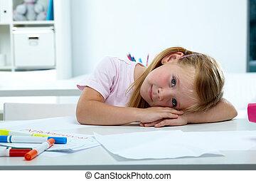 Cute girl - Portrait of lovely girl putting her head on desk